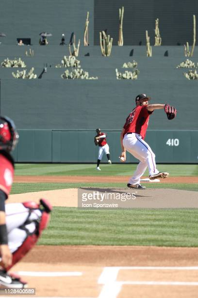 Diamondback starting pitcher Robbie Ray warms up before a spring training game between the Chicago Cubs and the Arizona Diamondbacks on March 1 at...