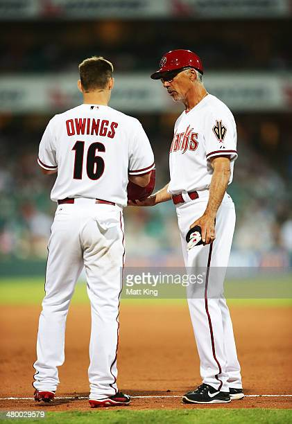 Diamondbacks first base coach Dave McKay speaks to Chris Owings during the opening match of the MLB season between the Los Angeles Dodgers and the...