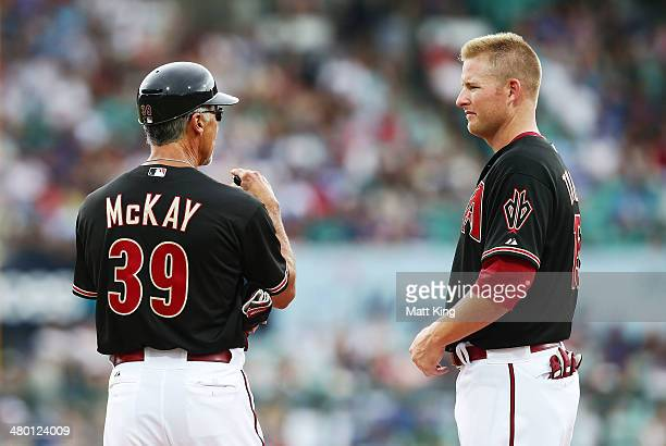 Diamondbacks first base coach Dave McKay speaks to Chris Trumbo during the MLB match between the Los Angeles Dodgers and the Arizona Diamondbacks at...
