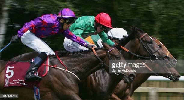 Diamonds and Dust ridden by Saleem Golam wins The Rolls Royce Motor Cars London Handicap Stakes run at Newmarket Racecourse on July 7 2005 in...