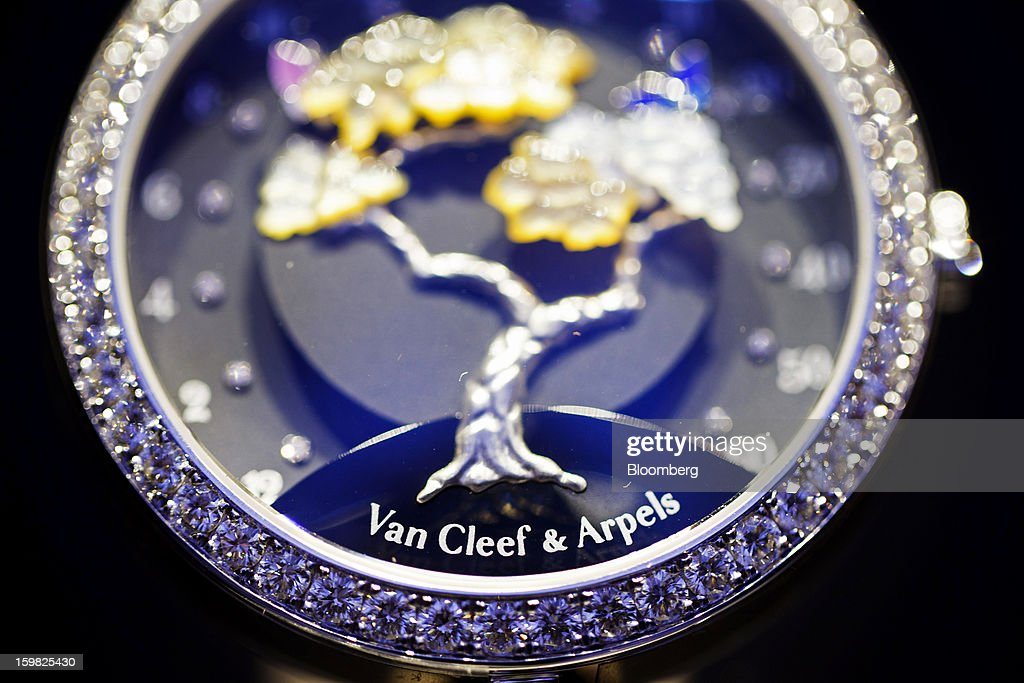 Diamonds are seen on the front of a Lady Arpels Butterfly Symphony watch manufactured by Van Cleef & Arpels, a unit of Cie. Financiere Richemont SA, on the first day of the Salon International de la Haute Horlogerie (SIHH) watch fair in Geneva, Switzerland, on Monday, Jan. 21, 2013. The Swiss watch industry slowed in the second half of 2012 as sales of timepieces and jewelry in Hong Kong, the biggest market for Swiss watchmakers, declined in August and October. Photographer: Valentin Flauraud/Bloomberg via Getty Images