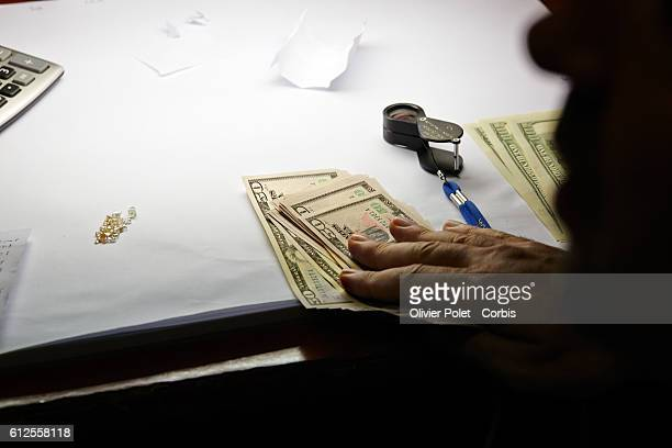 Diamonds calculator magnifying glass and US Dollars there is no doubt we are in a diamond buyer's office 28 March 2013 near an Angolan village not...
