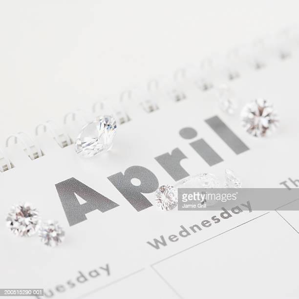 diamonds on april page of calendar - abril fotografías e imágenes de stock