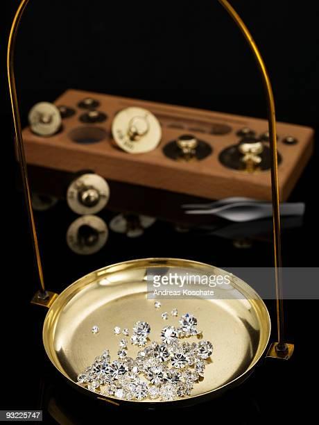 Diamonds on scale, close-up