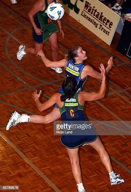 Diamonds wing defence Kimberly Horton competes for possesion with Flyers centre Renee Robins during the 4545 draw in the National Bank cup netball...