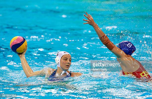 Diana Abla of Brazil is challenged by Cong Zhang of China during the Women's Water Polo 7th 8th Classification match between Brazil and China on Day...