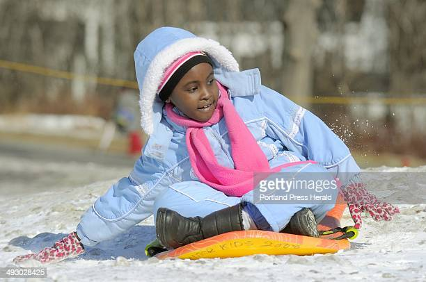Diana Aboda slows herself down after a fast slide down the Payson Park hill at the WinterKids event
