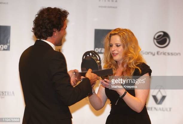 Diana Amft receives her trophy from Kai Schumann at the 2nd Orange Filmball Vienna at the Townhall on March 18, 2011 in Vienna, Austria.