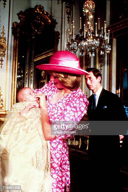 Diana and Prince Charles look on lovingly at baby Prince William on the day of his Christening at Buckingham Palace in 1982