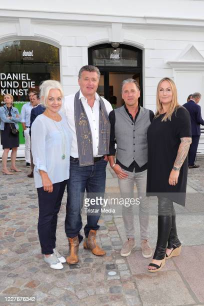 Diana Apitz her husband Bruno F Apitz and the gallerist Volker Daniel and Bianca Daniel during the Bruno F Apitz exhibition opening on July 17 2020...