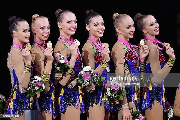 Diana Borisova Daria Kleshcheva Anastasiia Maksimova Sofya Skomorokh Anastasiia Tatareva and Maria Tolkacheva of Russia celebrate at the podium after...