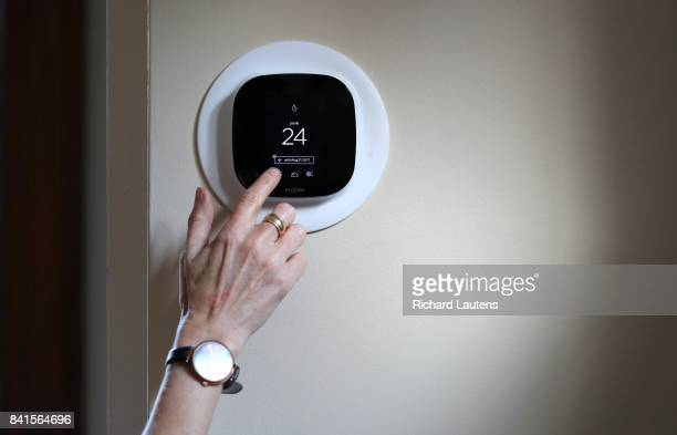 TORONTO ON AUGUST 30 Diana Carradine with Ecobee smart thermostat in her home in the Eglinton and Avenue road area The province is launching the...
