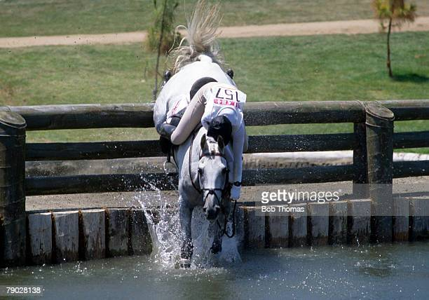 Diana Clapham of the Great Britain equestrian team falls from her horse 'Windjammer' at the seventh fence in the three day team eventing competition...