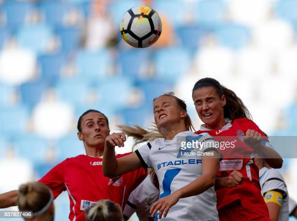 Diana Csanyi of MTK Hungaria FC competes for the ball in the air with Feride Kastrati of WFC Hajvalia and Zelfie Bajramaj of WFC Hajvalia during the...
