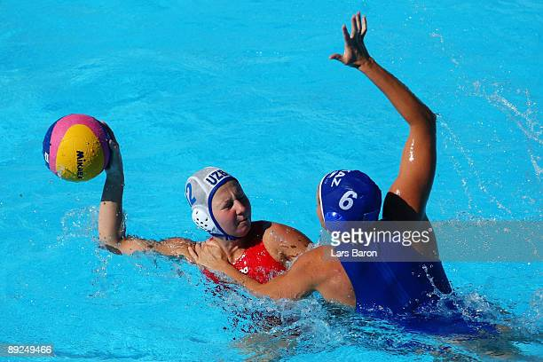 Diana Dadabaeva of Uzbekistan is challenged by Anna Zubkova of Kazakhstan in the Women's Water Polo Semifinals between Uzbekistan and Kazakhstan...