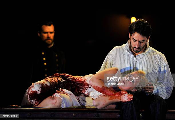 Diana Damrau as Lucia and Charles Castronovo as Edgardo with artists of the company in the Royal Opera's production of Gaetano Donizetti's 'Lucia Di...