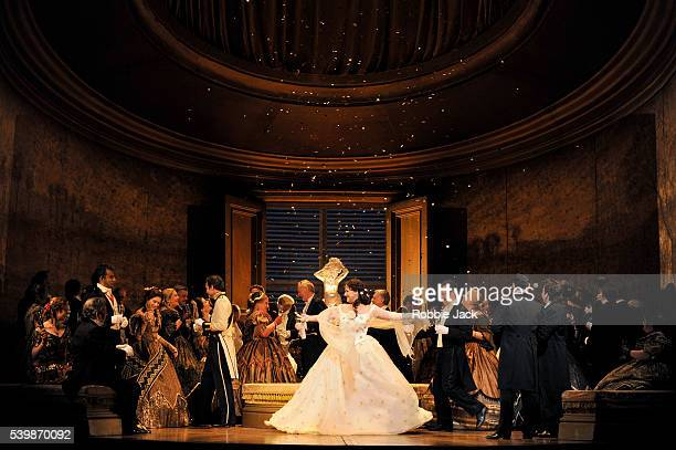 Diana Damrau as Violetta Valery with artists of the company in the Royal Opera's production of Giuseppe Verdi's La Traviata directed by Richard Eyre...