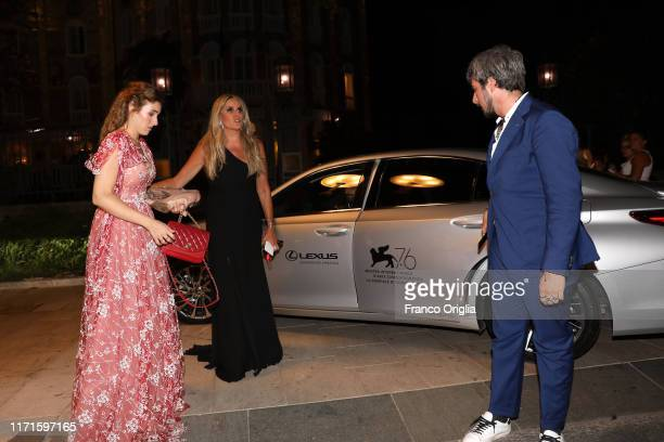 Diana Del Bufalo Tiziana Rocca and Paolo Ruffini attend the Filming In Italy After Party Arrivals on a Lexus car during the 76th Venice Film Festival...