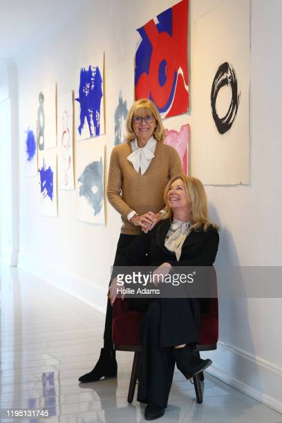 Diana Donovan with gallerist Lisa Norris in front of artworks by Diana's late husband Terence Donovan on January 21 2020 in London England Donovan...