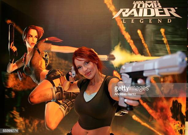 Diana Dorow a dressed as Lara Croft poses at the EIDOS stand to promote the newest Tomb Raider game on August 17 2005 in Leipzig Germany The...