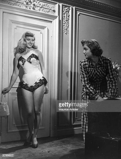 Diana Dors in her underwear with British actress Pauline Stroud in a scene from 'Lady Godiva Rides Again' a film about contestants in a beauty...