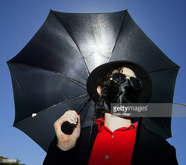 Diana Enola stands dressed like Michael Jackson outside Santa Barbara County courthouse following the Jackson pretrial hearing April 2 2004 in Santa...