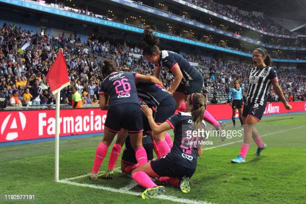 Diana Evangelista of Monterrey celebrates with teammates after scoring the first goal of his team during the final second leg match between Monterrey...