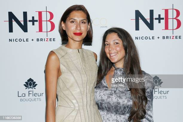 Diana Garcia and Heather Grabin attend the Beauty moguls Nikki and Brie Bella launch of their new product line during fashion week for Nicole and...