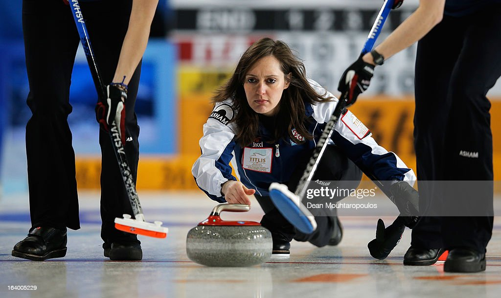 Diana Gaspari (C) of Italy looks on after throwning the stone in the match between Japan and Italy on Day 4 of the Titlis Glacier Mountain World Women's Curling Championship at the Volvo Sports Centre on March 19, 2013 in Riga, Latvia.