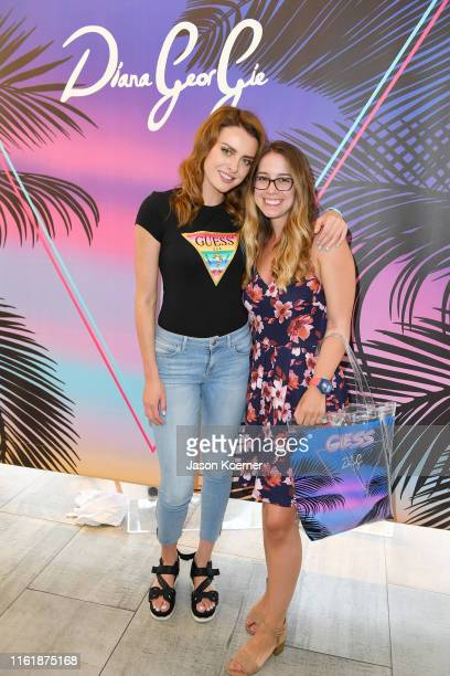 Diana Georgie and guest are seen during the GUESS Meet Greet To Celebrate Watch Collaboration During Miami Swim Week at GUESS Lincoln Road on July 13...