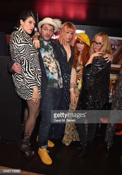 Diana Gomez guest DJ Henri guest and Erica Bergsmeds attend a private view of Free Woman An Exhibition by Diana Gomez at Blakes Hotel on October 4...
