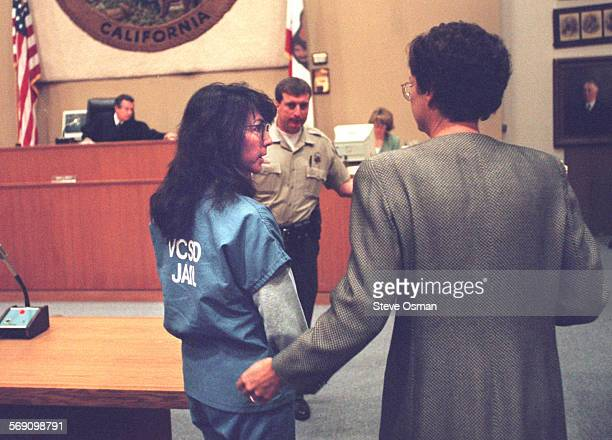 Diana Haun as she leaves Ventura County Superior Court wit h Deputy Public Defender Susan Olson at her side after her arraignment on charges she...