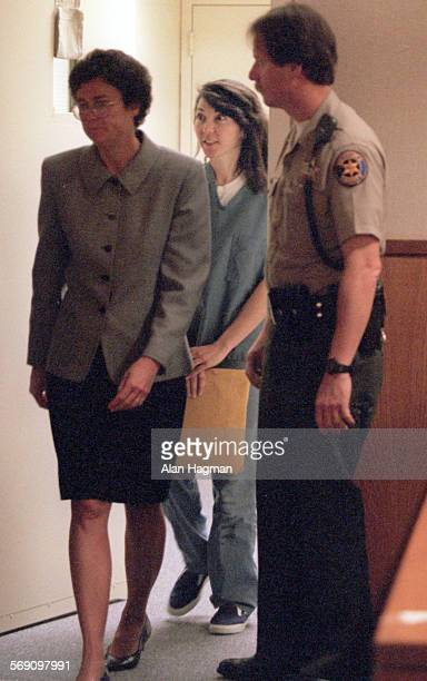 Diana Haun center enters courtroom Wednesday with attorney Susan Olson for arraignment on charges she murdered Sherri Dally Haun and Michael Dally...