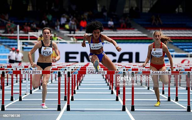 Diana Ioana Volf of Romania Dayana Liseth Ramos of Colombia and Triana Alonso of Peru in action during round one of the girls 100m Hurdles on day one...