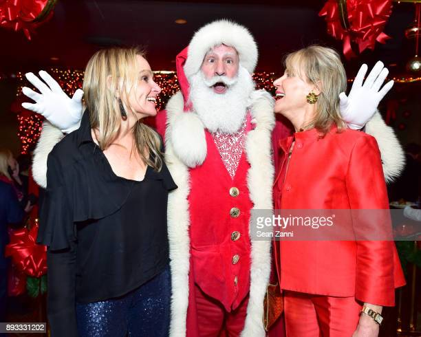 Diana Kellogg Santa Claus and Alison Spear attend A Christmas Cheer Holiday Party 2017 Hosted by George Farias and Anne and Jay McInerney at The...