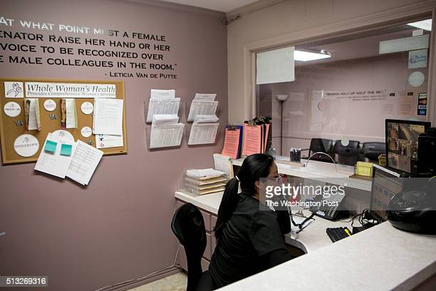 Diana Mejia, a receptionist at Whole Woman's Health of McAllen, answers a phone call. Whole Woman's Health of McAllen clinic remains open after HB2,...