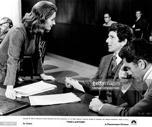 Diana Muldaur approaches Barry Newman and Robert Colbert in a scene from the film 'The Lawyer' 1970