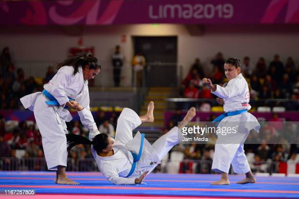 Diana Munoz Natalia Pachon and Camila Moreno of Colombia competes during Team Women's Kata Bronze Medal Bout 1 at Villa El Salvador Sports Center on...