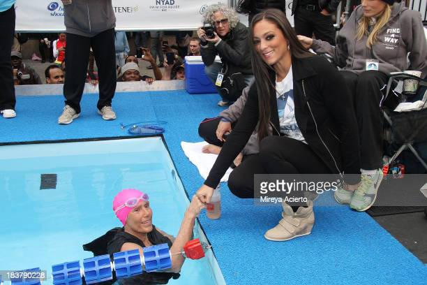 Diana Nyad and Sammi 'Sweetheart' Giancola attend 'Swim for Relief' Benefiting Hurricane Sandy Recovery at Herald Square on October 9 2013 in New...