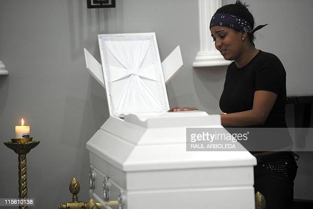 Diana Ospina Cordoba cries next to the coffin with the remains of her mother Ana Fabricia Cordoba Cabrera during the wake on June 8 in Medellin...