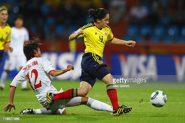 Diana Ospina of Colombia eludes Jon Myong Hwa of Korea DPR during the FIFA Women's World Cup 2011 Group C match between Korea DPR and Colombia at the...