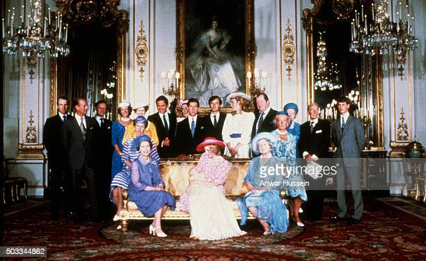 Diana, Princes of Wales, surrounded by family and friends, holds her baby son Prince William as she sits with Queen Elizabeth ll and Queen Elizabeth,...