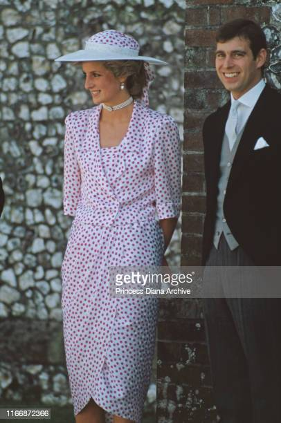 Diana Princess of Wales and her brotherinlaw Prince Andrew attend the wedding of Lady Carolyn Herbert and John Warren at Highclere in Hampshire UK...