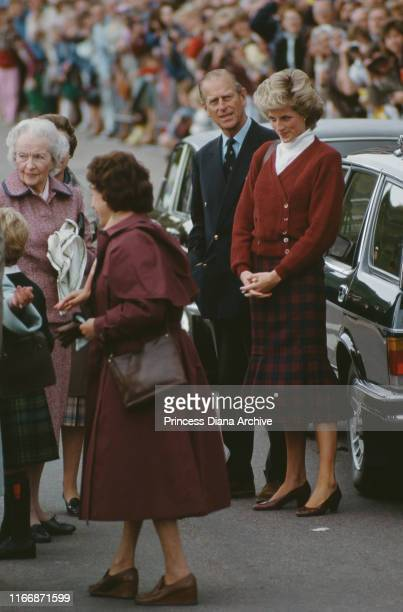 Diana Princess of Wales and her fatherinlaw Prince Philip are greeted by Ruth Lady Fermoy Diana's grandmother upon arrival in Scrabster Scotland...