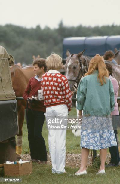 Diana, Princess of Wales and her friend Sarah Ferguson attend a polo match at Smith's Lawn, Guards Polo Club, Windsor, June 1983. Diana is wearing a...