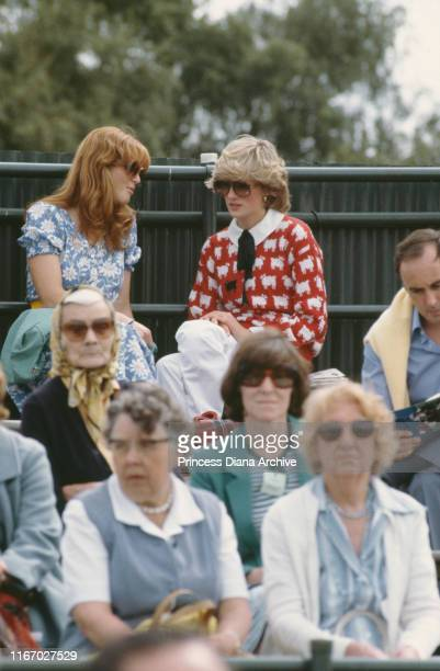 Diana Princess of Wales and her friend Sarah Ferguson attend a polo match at Smith's Lawn Guards Polo Club Windsor June 1983 Diana is wearing a Muir...