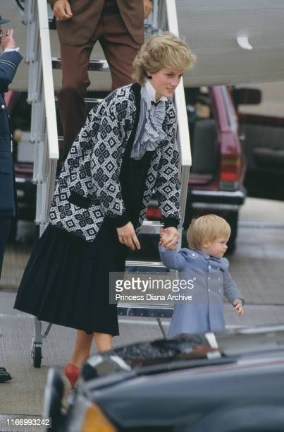 Diana Princess of Wales and her son Prince Harry arrive at Heathrow Airport by the Queen's Flight from Scotland September 1986