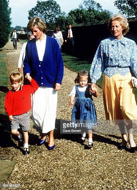 Diana, Princess of Wales and her son Prince Harry, walk with her mother Frances Shand Kydd and nice Eleanor Fellowes at the wedding rehearsal of her...