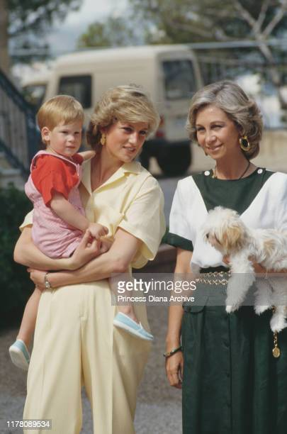 Diana, Princess of Wales and her son Prince Harry with Queen Sofia of Spain during a holiday with the Spanish royal family at the Marivent Palace in...