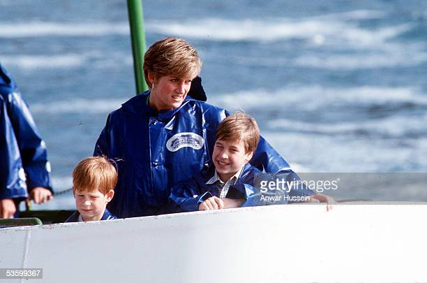 The Princess of Wales Prince William and Prince Harry wear waterproof capes on a visit to the Niagra Falls on October 28 1991 in Niagra Canada
